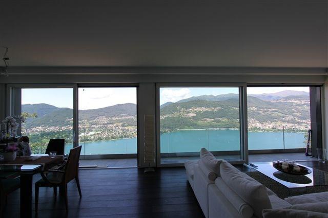 Stupendo nuovo penthouse con fantastica vista lago 13000421