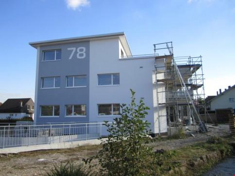 Erstvermietung im Zentrum 4.5 Zimmerwohnung im Erdgeschoss