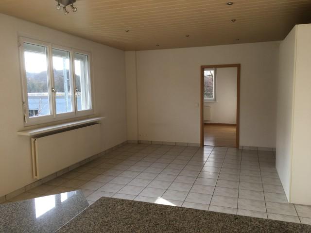 Wohnzimmer mit Plattenboden
