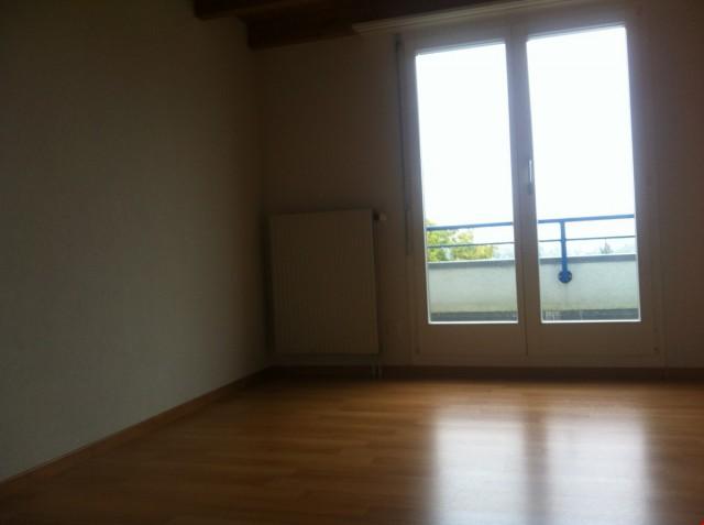 Schlafzimmer mit Laminatboden