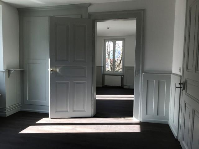 Zimmer mit Brusttäfer und Eichenparkett
