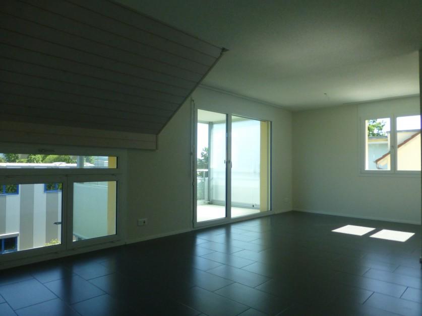 Dachgeschosswohnung mit verglastem Balkon