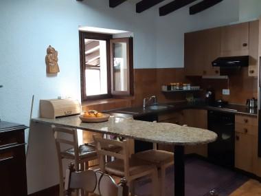 Appartamento in casa ticinese nel nucleo di Carabbia.