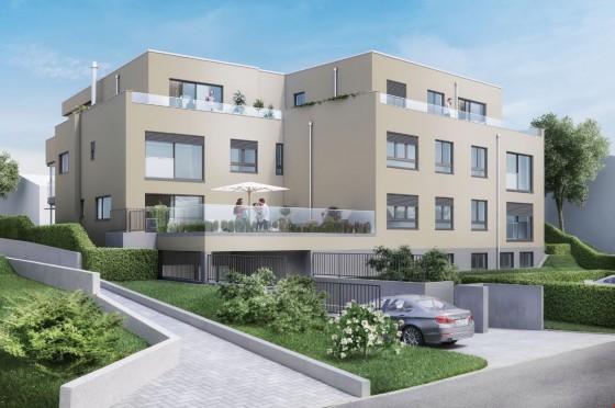 Ansicht der Nordfassade mit Sitzplatz der Wohnung W03