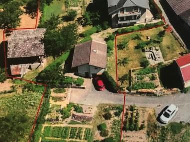 Maison de deux appartements, une grange, une maisonnette, parcelles