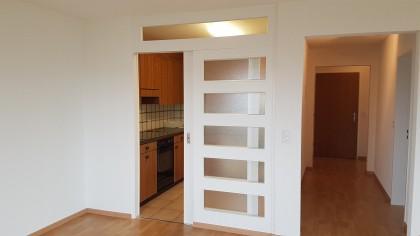 Küche mit Eingang und praktischer Schiebetüre